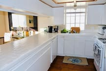Kitchen with large counter area, comes ready to cook in with all utensils pots and pans.