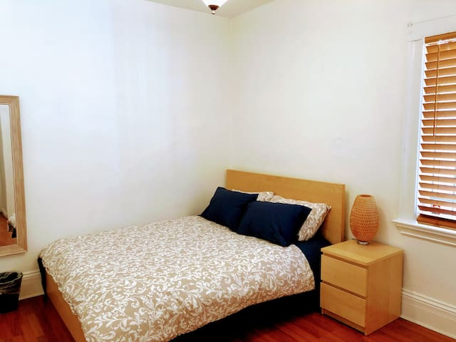 Second bedroom, queen-sized bed. Large closet with dresser and hangers. Portable fan, heater and personal cooling fan.