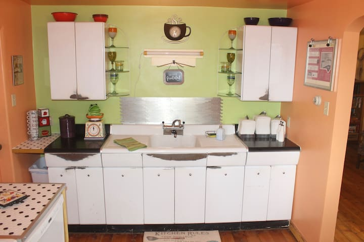 """These 'American Kitchen"""" Brand cabinets have seen many years of cooking!"""
