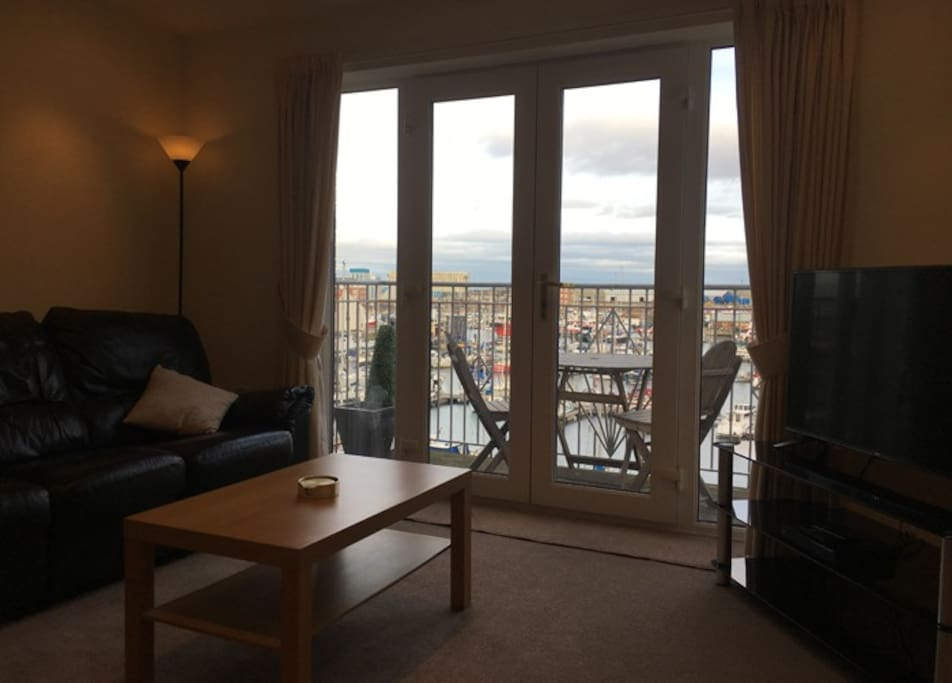 "Sitting room: Fantastic view over the marina and yachts. Within close walking distance to many restaurants, bars and shop. Smart 42"" TV with Netflix, iPlayer, You Tube, etc…, Blu-Ray and DVD player, Wi-Fi Internet access, 2 and 3 seater leather sofas, etc…"