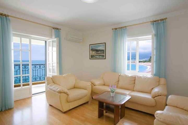 View of spacious living room of our three bedroom family apartment with access to the terrace, private beach and amazing bar and restaurant on the ground floor. Apartment has cable TV and high speed WiFi as well as beautiful sea view from the terrace