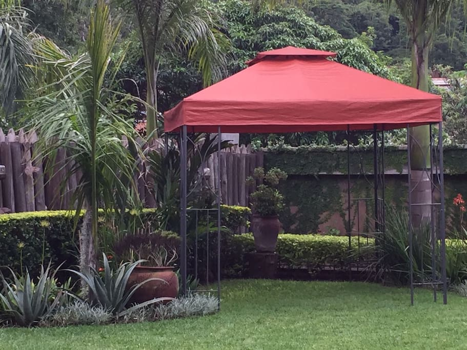 Permanent gazebo under which to sit, take a drink, read a book.