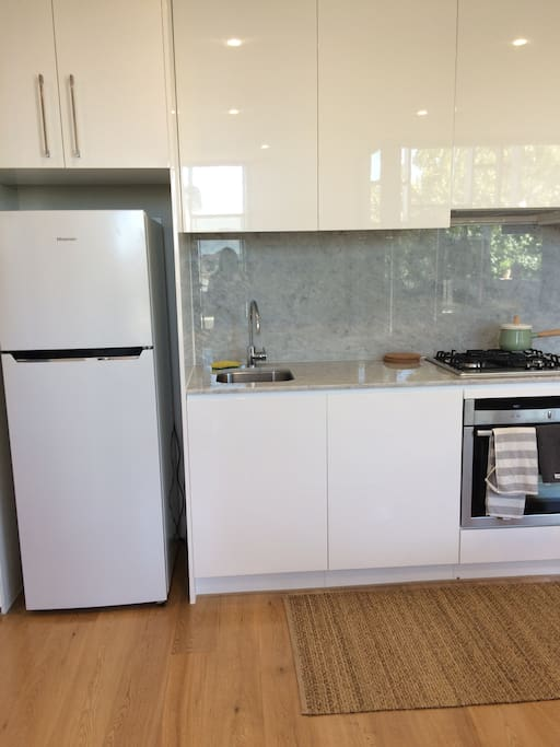 Kitchen (Dishwasher, oven, stainless steel appliances)