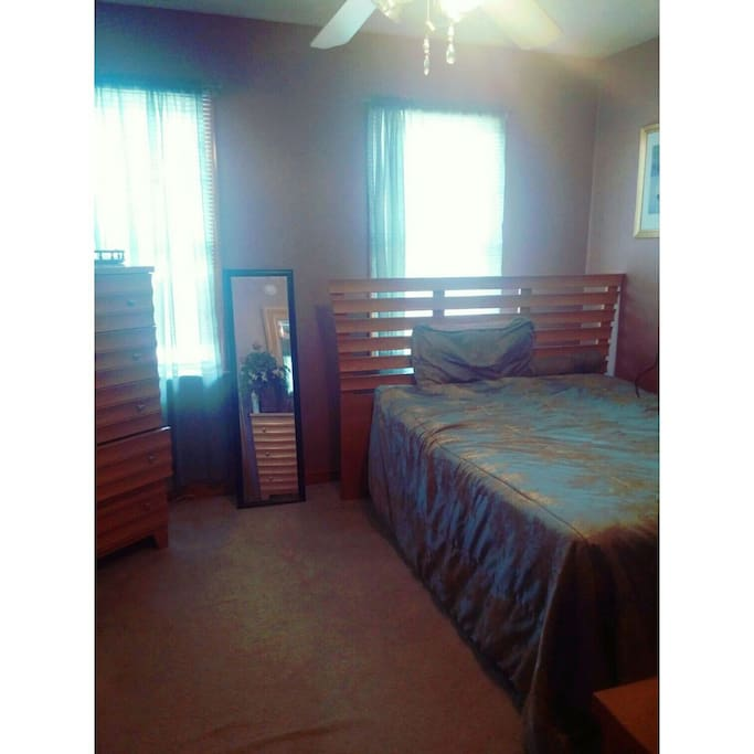 There are two available rooms, this is room 1. It fits two comfortably in the full size bed, closet space and dresser.