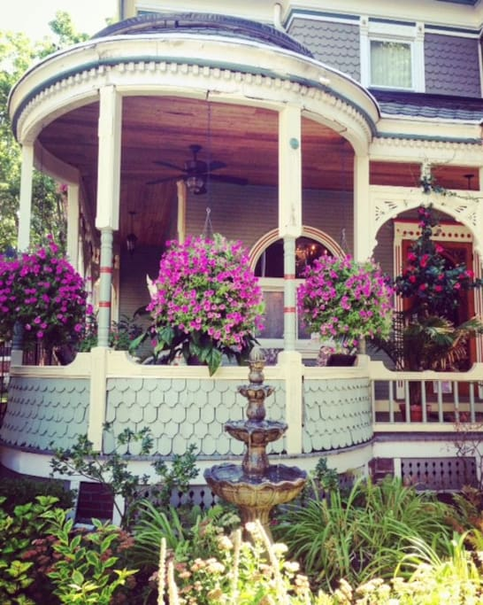 Beautiful plants adorn this Queen Anne Porch
