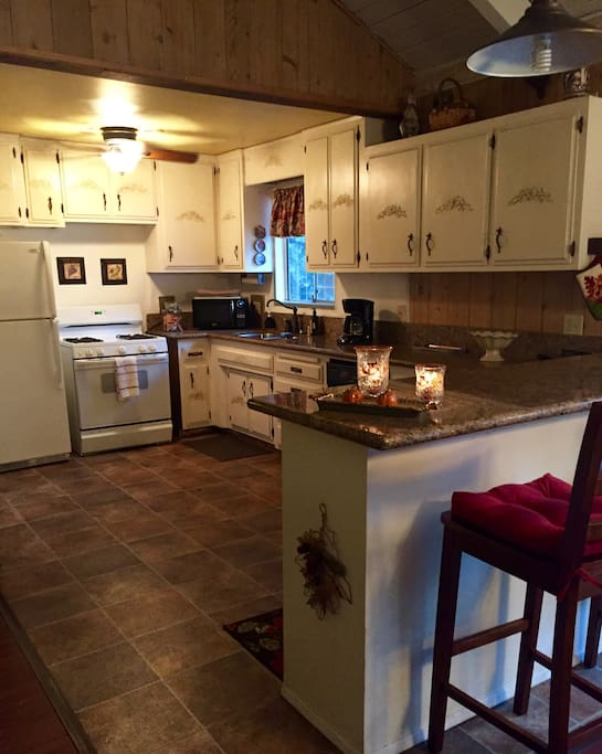 Large fully equipped kitchen off family room.