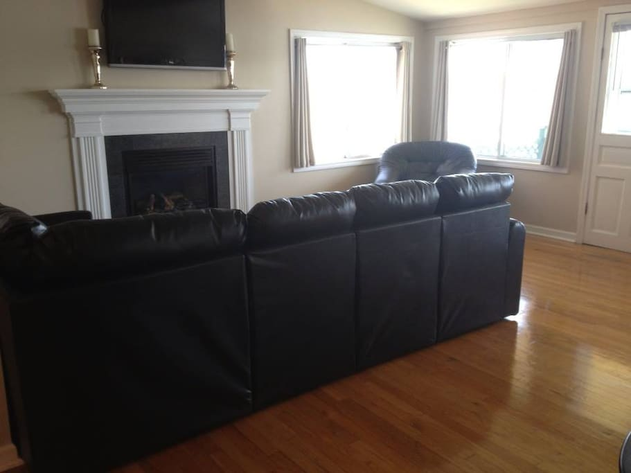 Living room with gas fireplace with cable TV