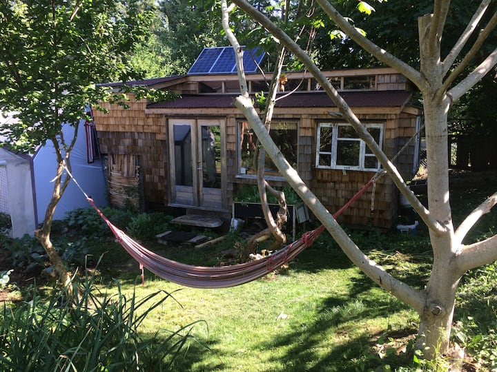 Off grid tiny house Organic garden  Down to earth
