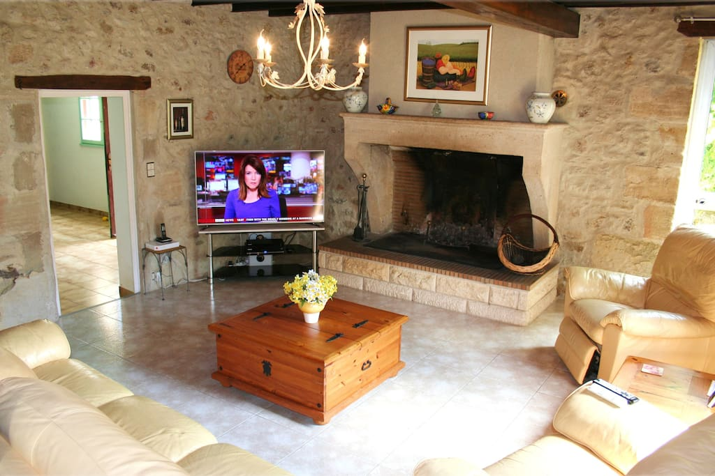 Lovely 11m x 5m Lounge. Leather suite, Open Stone fireplace, 55-inch LED HD TV with FreeSAT HD and Blu-ray. DVD/BR collection of around 100 of top movies for grown-up and kids.