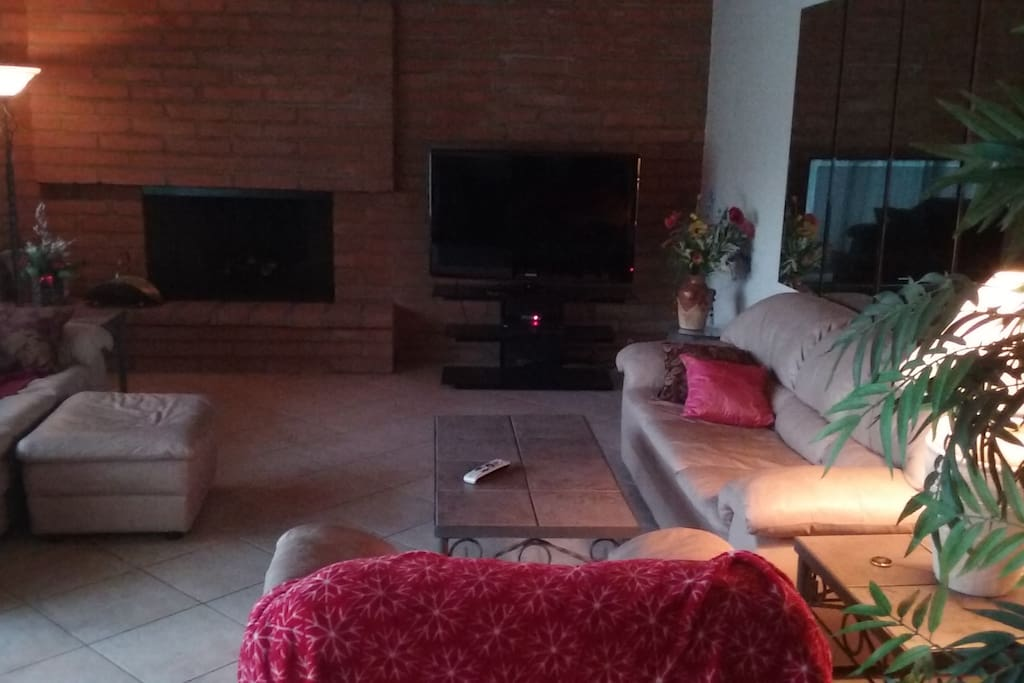 Common living room, with complete satellite TV programming and comfortable seating.