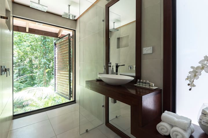 Enjoy rainforest views from the double walk in rainshower in the ensuite