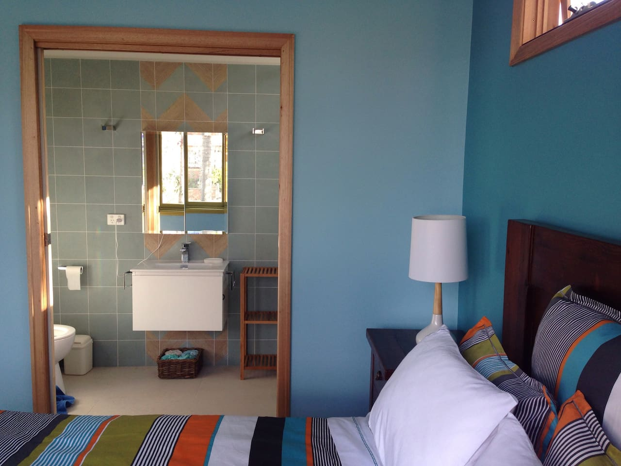 View of small bathroom from the bedroom.