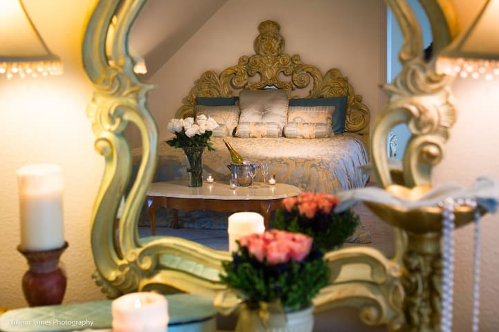 This two-room suite, with the capacity to sleep 4 guest..decorated in ornate French Provincial furnishings, palatial king-size pillowtop bed. The bedroom has attached a private parlor with a twin trundle bed & a private bath with a jetted tub.