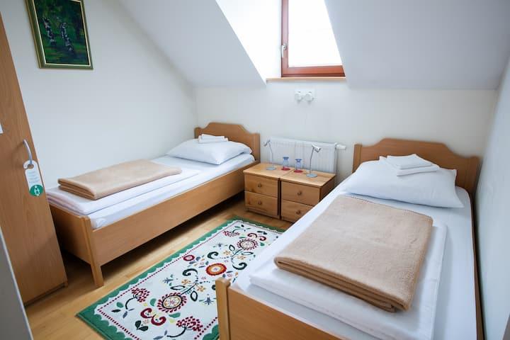 Twin room in a family-run B&B Pod Skalo