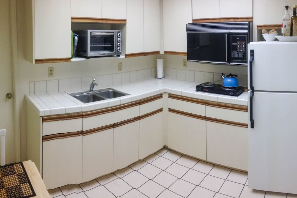 Kitchen includes convection oven and crockpot; along with microwave oven.