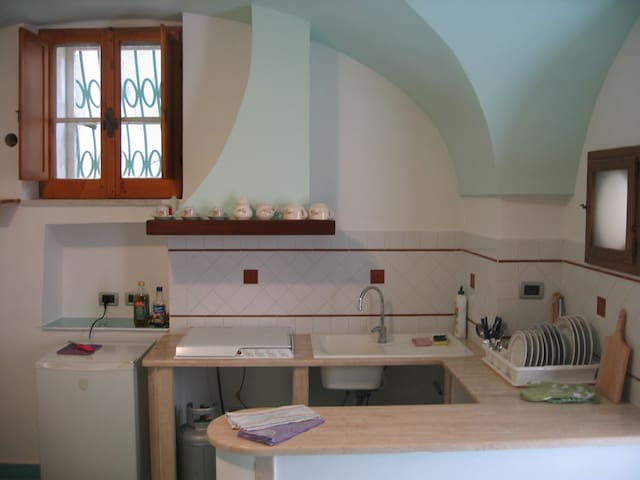 The kitchen. It is well equipped, all ready to cook your favourite dishes.
