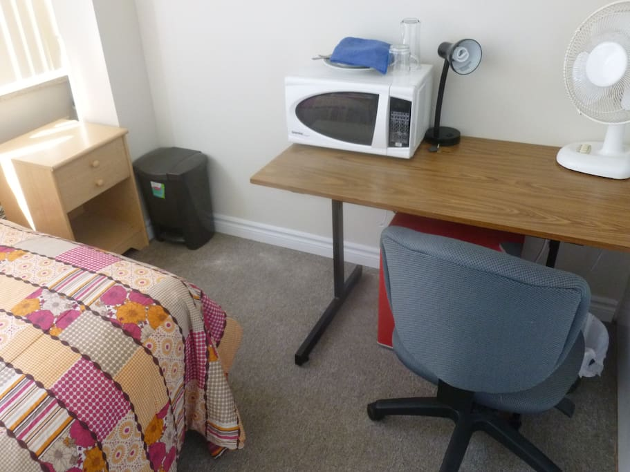 Writing desk, fridge & microwave for your convenience!
