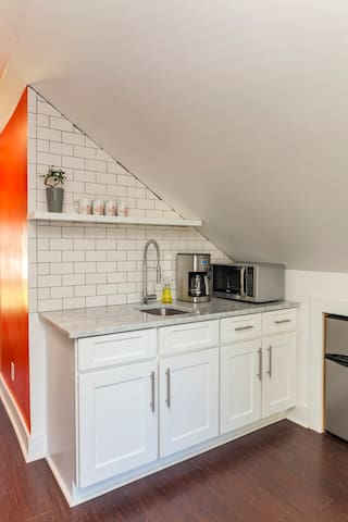 The kitchenette with coffee maker and microwave