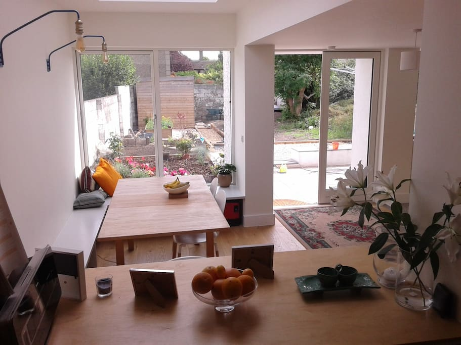 Spacious light-filled family room with dining space and kitchen