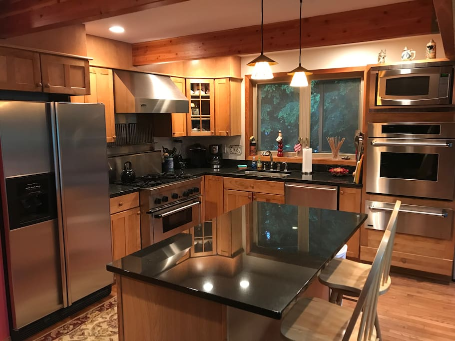 Gourmet Kitchen with professional appliances and granite counter tops.