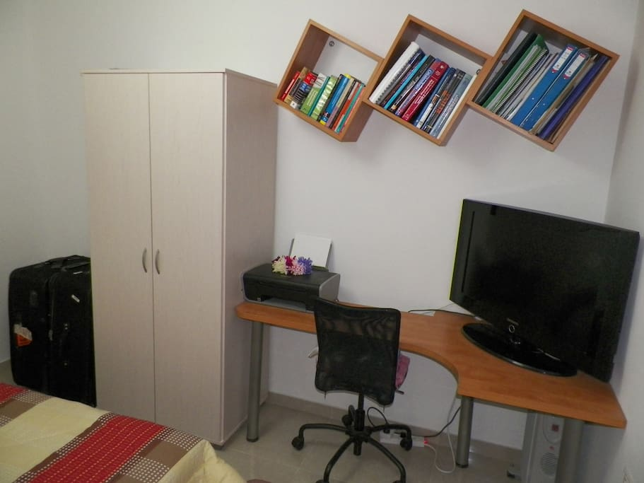 The guest room has a small closet a desk and a TV(local cable only)