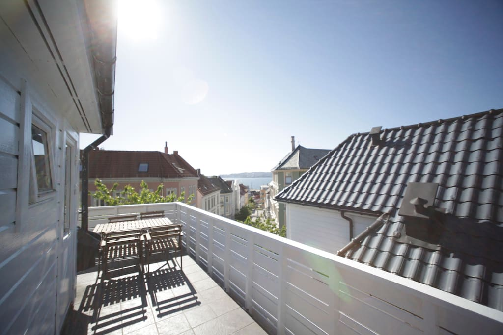 The balcony that you share with other guests is wonderful. Imagine sitting here enjoying the view of the Bergen