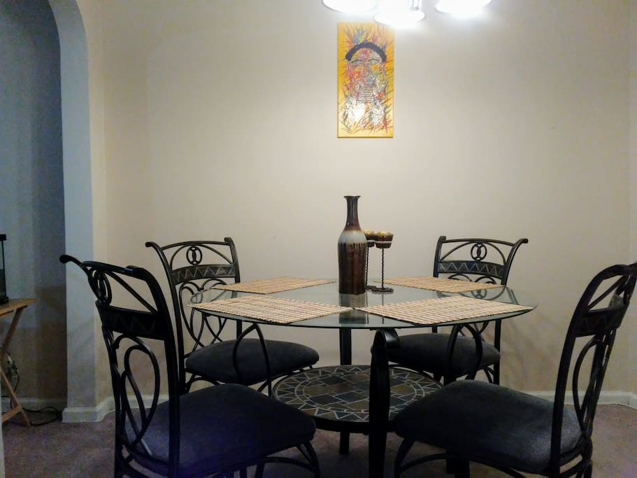 Our dinning table comfortably fits four. Other chairs are available to add to the table if needed.