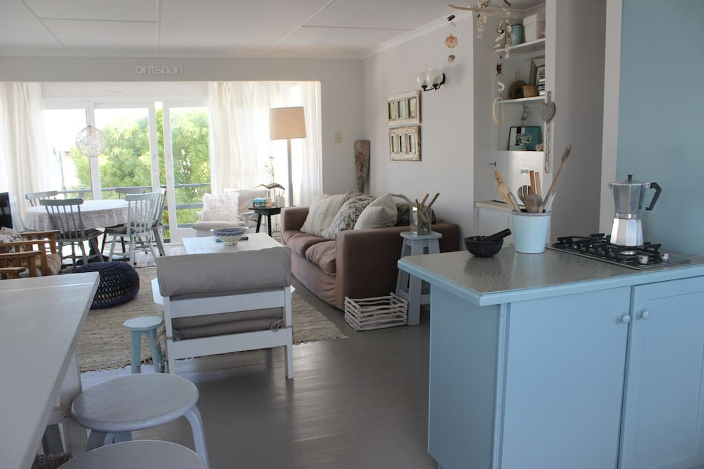 The contemporary open plan living space, newly painted & styled.