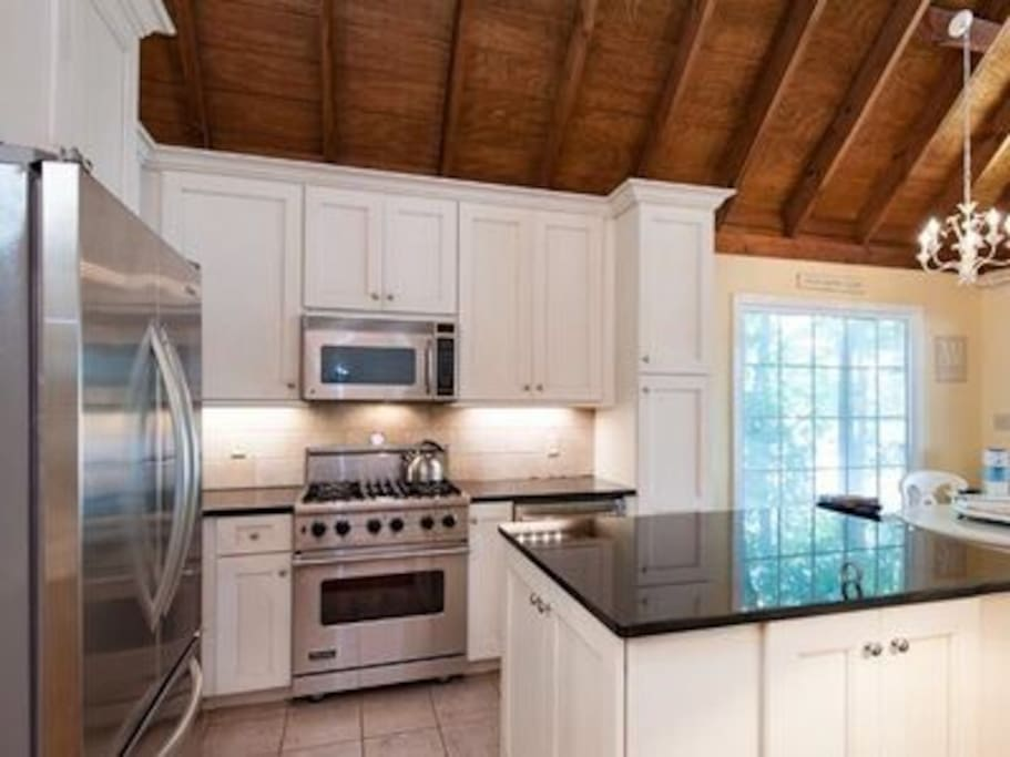 Enjoy this beautiful gourmet kitchen with a Viking gas range and more than enough cooking utensils!