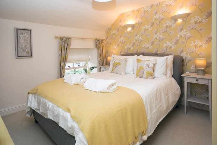 Yellow bedroom with a King Sized bed