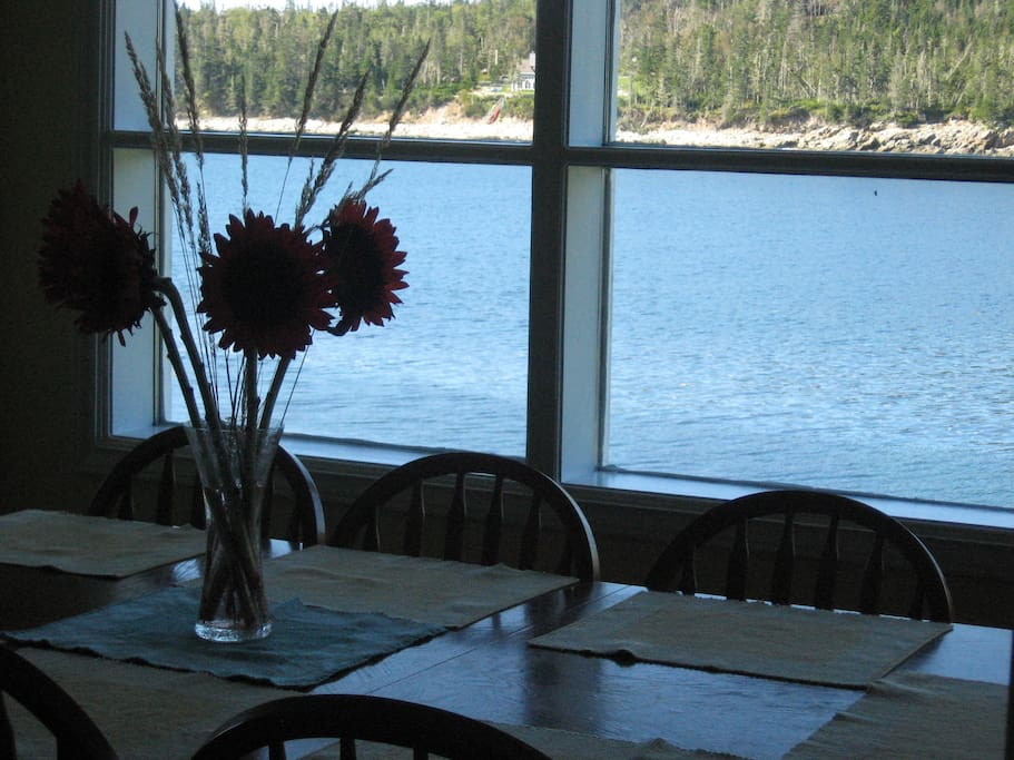 The livingroom/dining area overlooks the water.