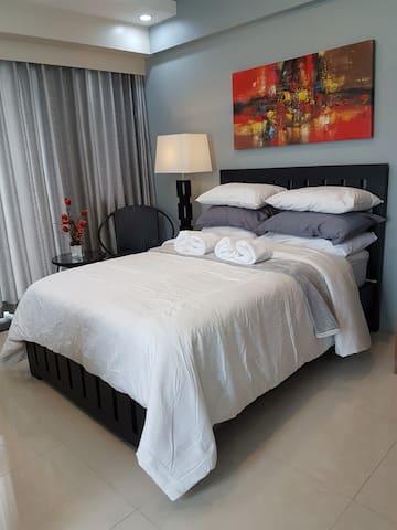 Cozy Executive Studio unit across NAIA T3 - Pasay - Bed & Breakfast
