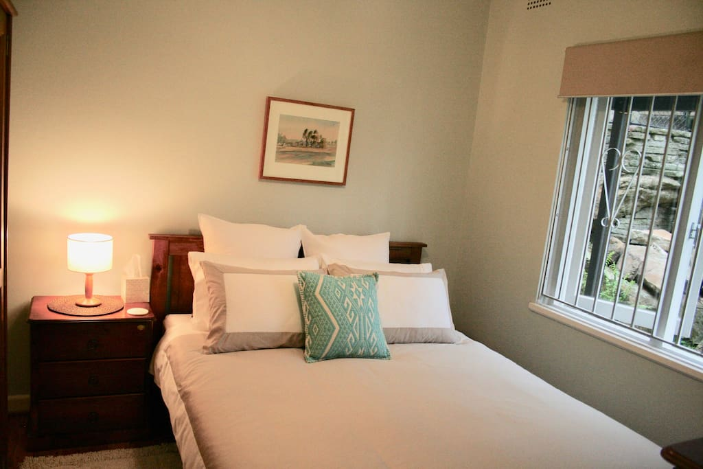 Queen bed, bright and airy room with sunblock blind for those who enjoy a sleep in.