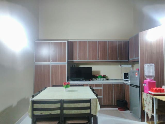 Pantry with TV, microwave, fridge, kettle and water dispenser with coffee/tea making facilities