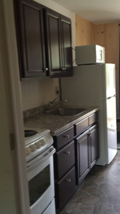 Kitchen in our 1 bedroom cottages with screened in porches.