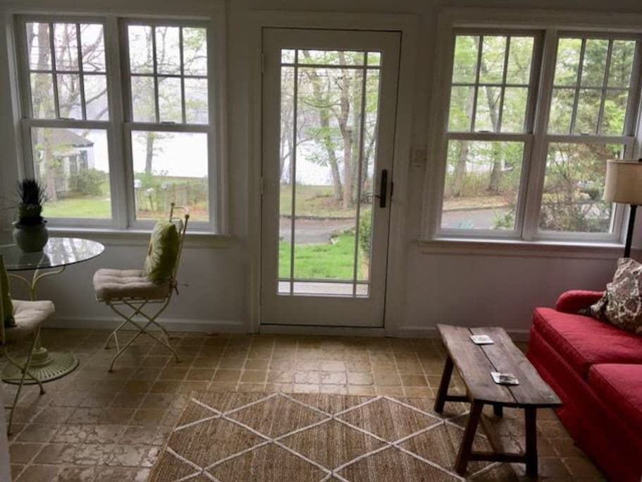 Sunroom with view of pond