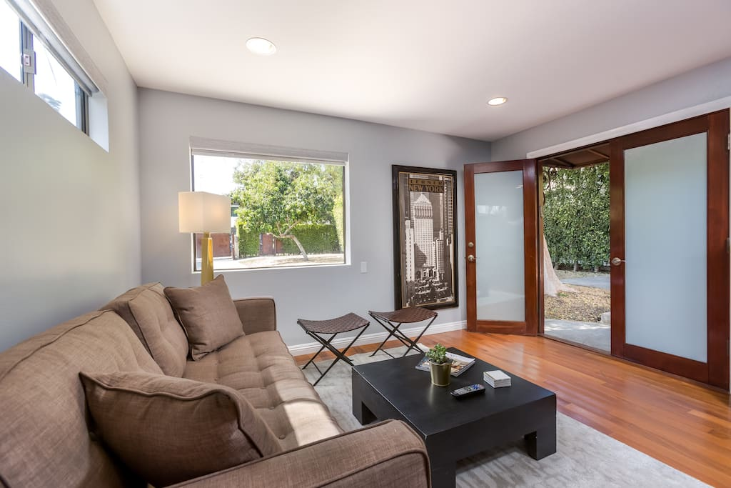 Family room: Great place to read a book, watch satellite TV, or keep the French doors open and enjoy a nice breeze.