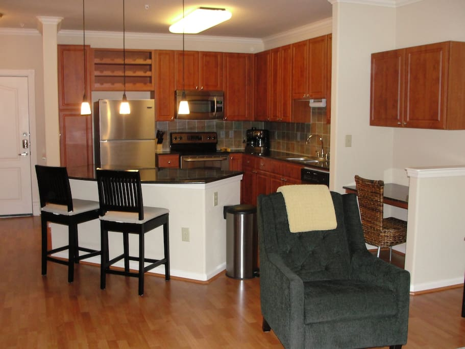 Kitchen opens into living and dining areas.
