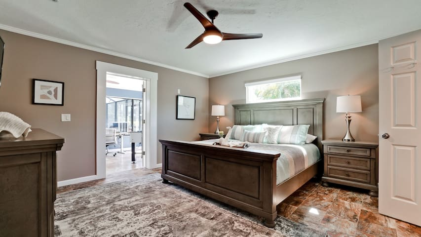Master bedroom with a beautiful view and access to the sunroom and pool area.