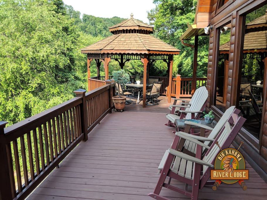 Top balcony has gazebo, table & six chairs & rocking chairs overlooking river