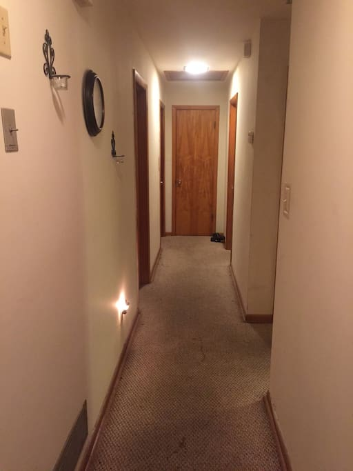 Hallway to the bathroom, 1st door on right hand side.