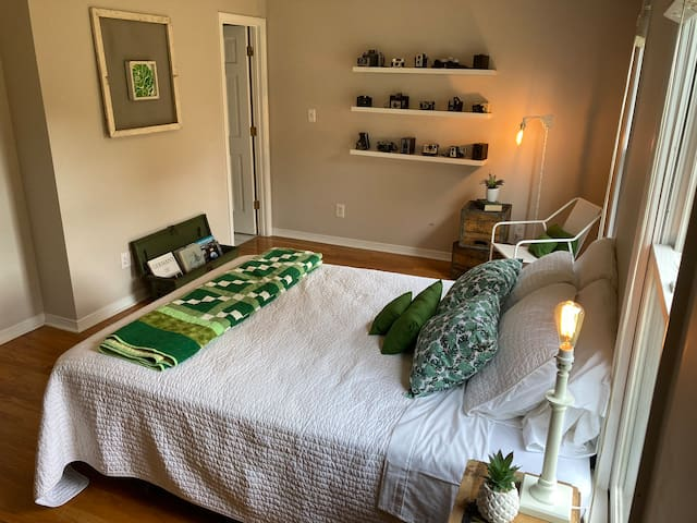 The Green Room offers a mix of modern and antique with a comfortable queen bed, sitting area and fully stocked coffee bar.