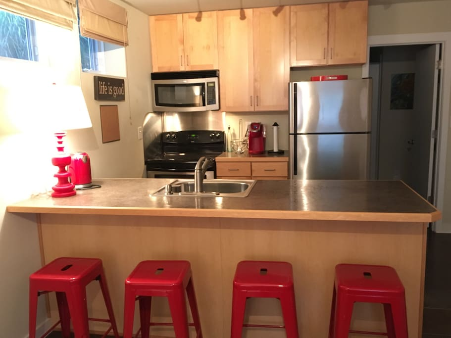 The kitchen is fully stocked and includes a microwave, full fridge and stove/oven, disposal, coffee maker, and  dishwasher.