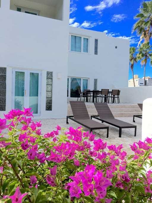 2nd Floor Beach-View Terrace with Dining Table & Chaise Lounges