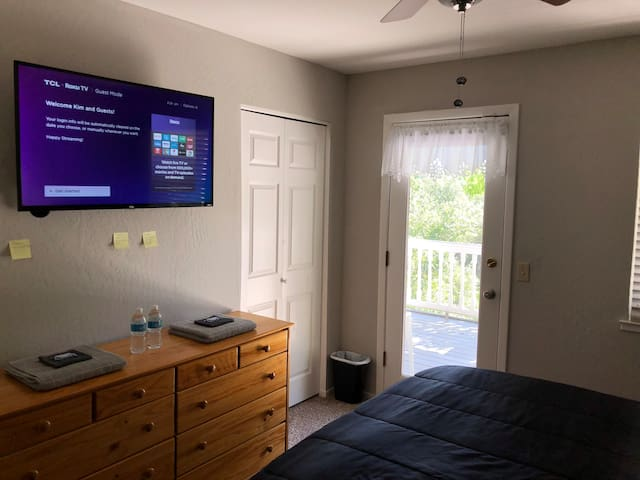 Guest Bedroom opens up to your private deck. This room is voice controlled. You have control of the smart home in this room. Use your voice to control lights, heat/air, TV, make coffee, and more.