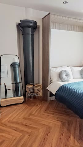 Bed, side table and mirror