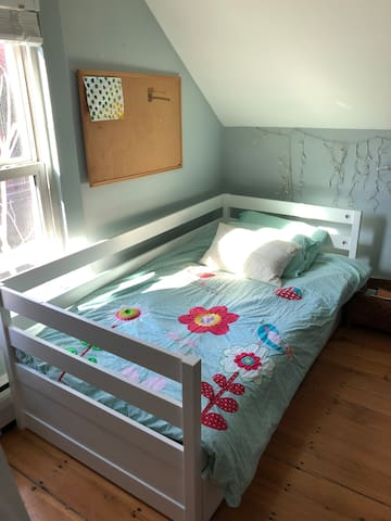Bedroom three: Playroom with single bed and trundle bed.