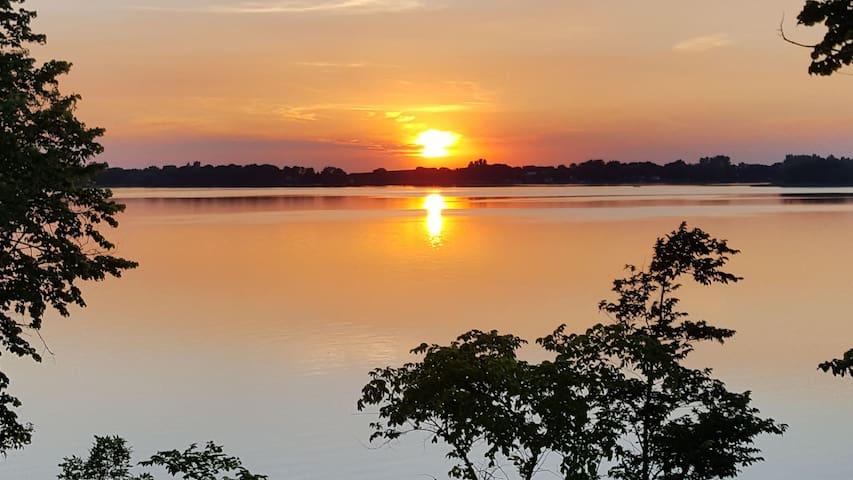 Great Minnesota getaway! 32' RV on a lake lot.