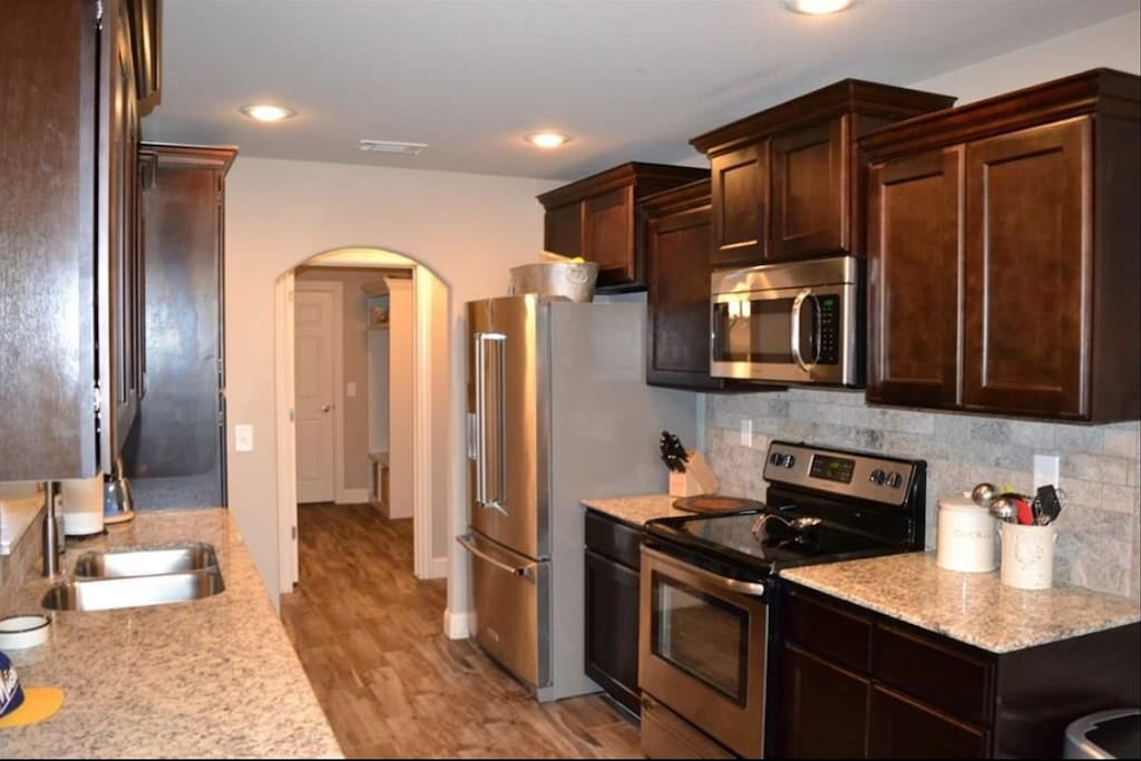 Kitchen which includes oven, microwave, dishwasher and refrigerator.