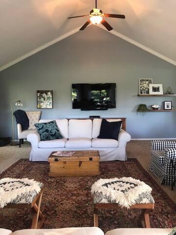 "Family Room w/ 60"" flat screen & 2 sofas"